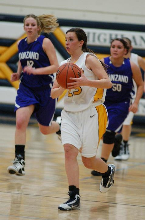 Photo of Highland girls basketball team member playing