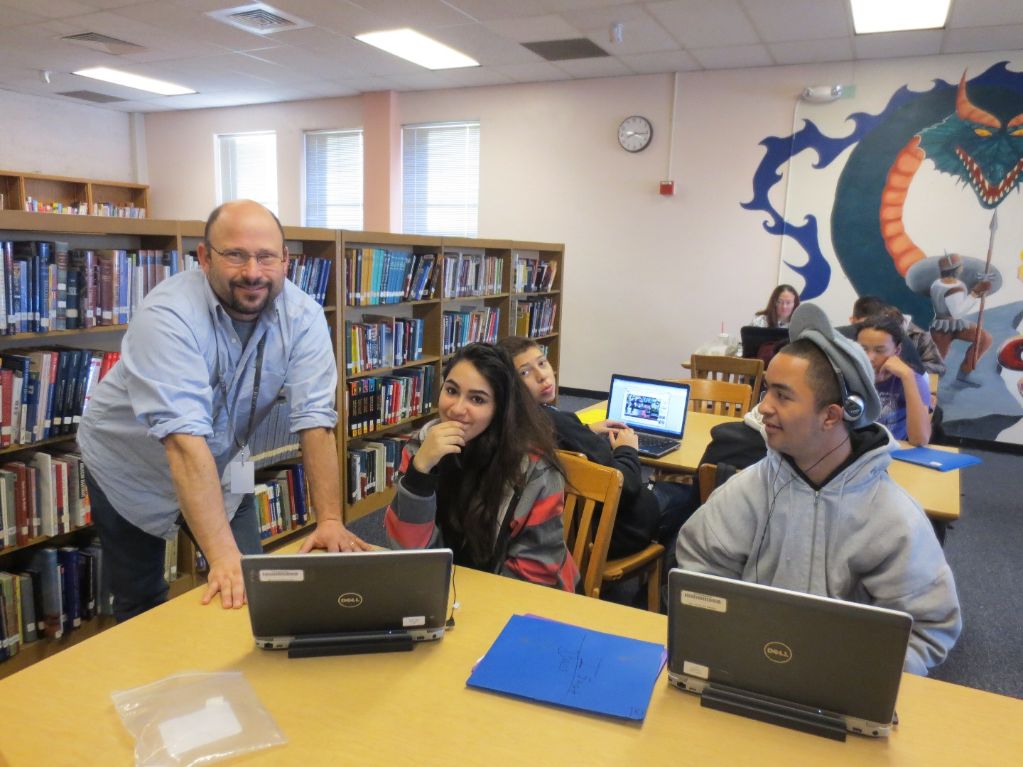 Photo of Librarian and students working in the Library